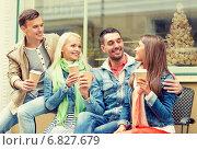 Купить «group of smiling friends with take away coffee», фото № 6827679, снято 14 июня 2014 г. (c) Syda Productions / Фотобанк Лори