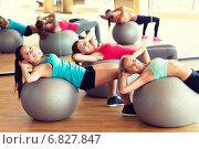 Купить «group of smiling women with exercise balls in gym», фото № 6827847, снято 7 июня 2014 г. (c) Syda Productions / Фотобанк Лори