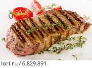 Купить «Beef steak with herbs», фото № 6829891, снято 9 декабря 2014 г. (c) Tatjana Baibakova / Фотобанк Лори