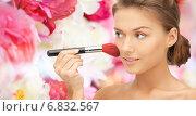 Купить «beautiful smiling woman with make up brush», фото № 6832567, снято 28 августа 2011 г. (c) Syda Productions / Фотобанк Лори