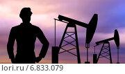 Купить «black silhouette of oil worker and pump jack», фото № 6833079, снято 20 октября 2019 г. (c) Syda Productions / Фотобанк Лори