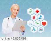 Купить «smiling doctor with tablet pc and medical symbols», фото № 6833099, снято 15 апреля 2014 г. (c) Syda Productions / Фотобанк Лори