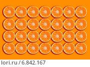 Купить «Фон из ломтиков апельсина», фото № 6842167, снято 19 декабря 2010 г. (c) MMISTUDIO / Фотобанк Лори
