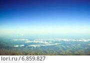 Вид с воздуха на заснеженные горы. Стоковое фото, фотограф Игорь Чайковский / Фотобанк Лори