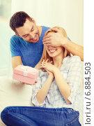 Купить «smiling man surprises his girlfriend with present», фото № 6884503, снято 9 февраля 2014 г. (c) Syda Productions / Фотобанк Лори
