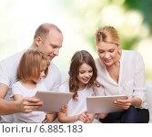 Купить «happy family with tablet pc computers», фото № 6885183, снято 1 марта 2014 г. (c) Syda Productions / Фотобанк Лори