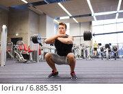 Купить «young man flexing muscles with barbell in gym», фото № 6885351, снято 30 ноября 2014 г. (c) Syda Productions / Фотобанк Лори
