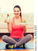 Купить «smiling teenage girl with green salad at home», фото № 6885631, снято 1 апреля 2014 г. (c) Syda Productions / Фотобанк Лори