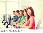 Купить «female student with classmates in computer class», фото № 6886827, снято 4 мая 2014 г. (c) Syda Productions / Фотобанк Лори