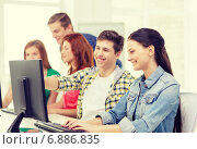 Купить «female student with classmates in computer class», фото № 6886835, снято 4 мая 2014 г. (c) Syda Productions / Фотобанк Лори