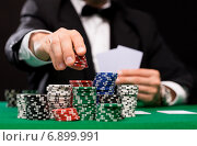 Купить «poker player with cards and chips at casino», фото № 6899991, снято 16 мая 2014 г. (c) Syda Productions / Фотобанк Лори
