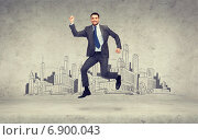 Купить «smiling businessman jumping», фото № 6900043, снято 21 июля 2019 г. (c) Syda Productions / Фотобанк Лори
