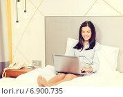 Купить «happy businesswoman with laptop in hotel room», фото № 6900735, снято 23 ноября 2013 г. (c) Syda Productions / Фотобанк Лори