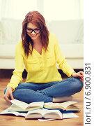 Купить «smiling student girl reading books at home», фото № 6900831, снято 19 марта 2014 г. (c) Syda Productions / Фотобанк Лори