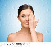 Купить «smiling young woman covering face with hand», фото № 6900863, снято 6 января 2013 г. (c) Syda Productions / Фотобанк Лори