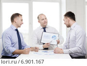 Купить «smiling businessmen with papers in office», фото № 6901167, снято 10 мая 2014 г. (c) Syda Productions / Фотобанк Лори