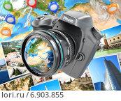 Digital photo camera on background from earth and photographs. Стоковое фото, фотограф Maksym Yemelyanov / Фотобанк Лори
