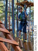 Купить «Мальчик на веревочном аттракционе», фото № 6920135, снято 1 июля 2013 г. (c) Дмитрий Боков / Фотобанк Лори