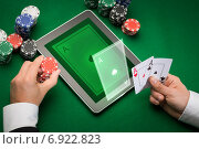 Купить «casino poker player with cards, tablet and chips», фото № 6922823, снято 16 мая 2014 г. (c) Syda Productions / Фотобанк Лори