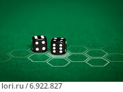 Купить «close up of black dice on green casino table», фото № 6922827, снято 17 октября 2014 г. (c) Syda Productions / Фотобанк Лори