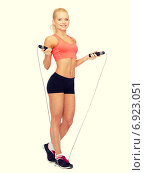 smiling sporty woman with with skipping rope. Стоковое фото, фотограф Syda Productions / Фотобанк Лори