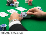 Купить «poker player with cards and chips at casino», фото № 6923427, снято 16 мая 2014 г. (c) Syda Productions / Фотобанк Лори