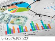 Бизнес-план и доллары США. Стоковое фото, фотограф Maselko Vitaliy / Фотобанк Лори