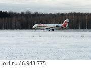 Купить «Приземление самолета Bombardier CRJ 100 компании «Руслайн»», фото № 6943775, снято 26 января 2015 г. (c) Nikolay Pestov / Фотобанк Лори