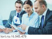 Купить «business team with tablet pc having discussion», фото № 6945479, снято 9 ноября 2013 г. (c) Syda Productions / Фотобанк Лори