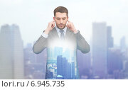 Купить «annoyed businessman covering ears with his hands», фото № 6945735, снято 15 марта 2014 г. (c) Syda Productions / Фотобанк Лори