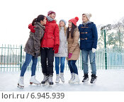 Купить «happy friends ice skating on rink outdoors», фото № 6945939, снято 22 декабря 2014 г. (c) Syda Productions / Фотобанк Лори
