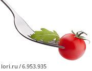 Fresh rucola salad and cherry tomato on fork isolated on white background cutout. Стоковое фото, фотограф Natalja Stotika / Фотобанк Лори