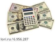 Купить «Бизнес-натюрморт с предметами бизнеса. Доллары и калькулятор», эксклюзивное фото № 6956287, снято 30 января 2015 г. (c) Юрий Морозов / Фотобанк Лори