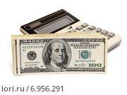 Купить «Бизнес-натюрморт с предметами бизнеса. Доллары и калькулятор», эксклюзивное фото № 6956291, снято 30 января 2015 г. (c) Юрий Морозов / Фотобанк Лори