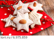Купить «Gingerbread cookies in star shape decorated with almonds. Festive dessert», фото № 6975859, снято 22 июля 2018 г. (c) BE&W Photo / Фотобанк Лори