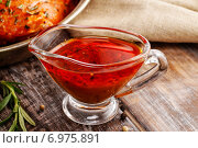 Купить «Honey and pepper red marinade in glass gravy boat on wooden table», фото № 6975891, снято 16 июля 2018 г. (c) BE&W Photo / Фотобанк Лори