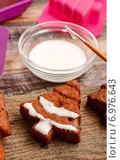 Купить «Decorating christmas gingerbread chocolate cookies with white icing. Festive dessert», фото № 6976643, снято 22 января 2020 г. (c) BE&W Photo / Фотобанк Лори