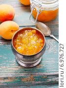 Купить «Vintage silver goblet of peach jam standing on a rustic wooden table», фото № 6976727, снято 20 ноября 2018 г. (c) BE&W Photo / Фотобанк Лори