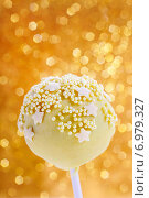 Купить «Pink and yellow cake pops decorated with sprinkles. Gold glittering background», фото № 6979327, снято 23 марта 2019 г. (c) BE&W Photo / Фотобанк Лори