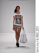 Купить «NEW YORK - SEPTEMBER 11: A Model walks runway for Mister Triple X Spring/Summer 2015 presentation at Mercedes-Benz Fashion Week at Lincoln Center during New York Fashion Week on September 11, 2014 in NYC.», фото № 6982251, снято 11 сентября 2014 г. (c) Anton Oparin / Фотобанк Лори
