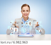 Купить «businesswoman with tablet pc and icons of contacts», фото № 6982963, снято 19 января 2014 г. (c) Syda Productions / Фотобанк Лори