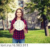Купить «young woman in casual clothes with wall clock», фото № 6983911, снято 26 февраля 2014 г. (c) Syda Productions / Фотобанк Лори