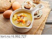 Купить «Portion of the sour rye soup made of soured rye flour and meat (usually boiled pork sausage or pieces of smoked sausage, bacon or ham)», фото № 6992727, снято 17 августа 2018 г. (c) BE&W Photo / Фотобанк Лори