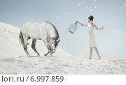 Купить «Fine shot of the sensual lady with the horse», фото № 6997859, снято 11 июня 2014 г. (c) Ingram Publishing / Фотобанк Лори
