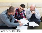 Купить «Three men with documents», фото № 7003099, снято 12 июля 2020 г. (c) Яков Филимонов / Фотобанк Лори