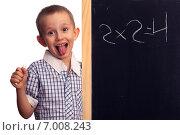 Купить «Мальчик у школьной доски показывает язык», фото № 7008243, снято 24 ноября 2014 г. (c) Барковский Семён / Фотобанк Лори