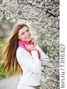 Купить «Beautiful girl in the lush spring garden.», фото № 7010827, снято 18 июня 2019 г. (c) Александр Савченко / Фотобанк Лори