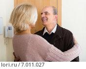 Купить «Mature wife meeting husband near door», фото № 7011027, снято 25 апреля 2019 г. (c) Яков Филимонов / Фотобанк Лори