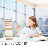 Купить «happy girl with books and notebook at school», фото № 7032119, снято 31 июля 2013 г. (c) Syda Productions / Фотобанк Лори