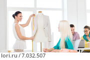 smiling fashion designers working in office. Стоковое фото, фотограф Syda Productions / Фотобанк Лори